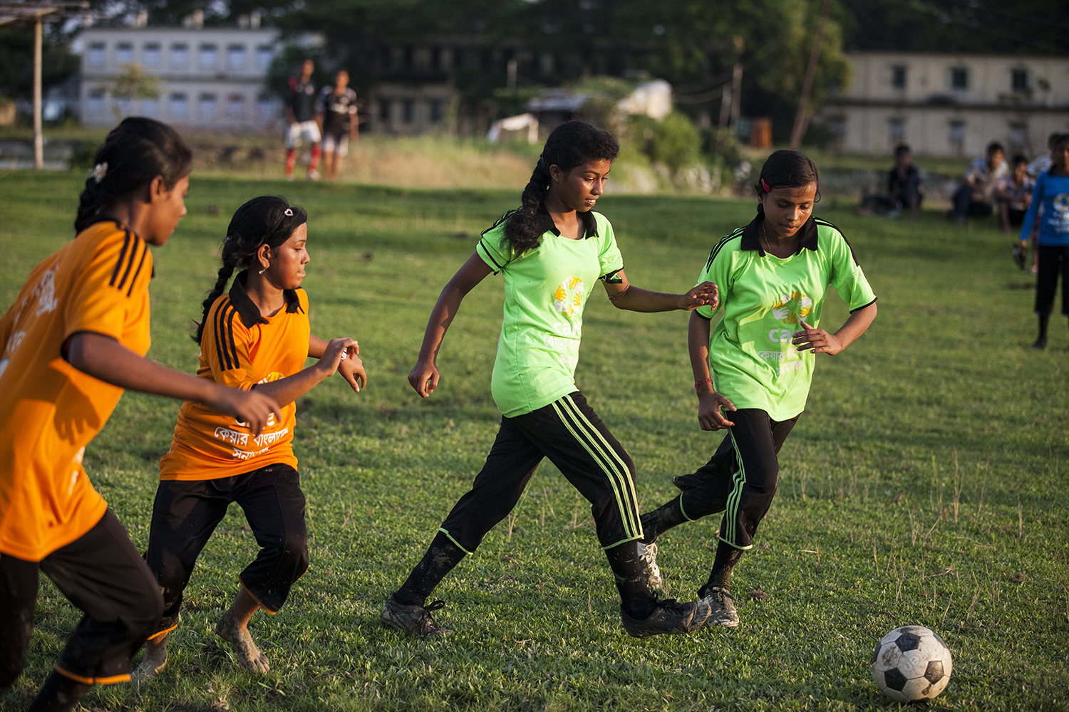 Girls playing football with support from the Tipping Point project