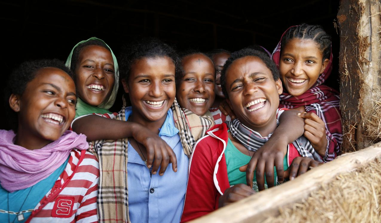 Girls laughing at a school in Ethiopia. Copyright: DFID