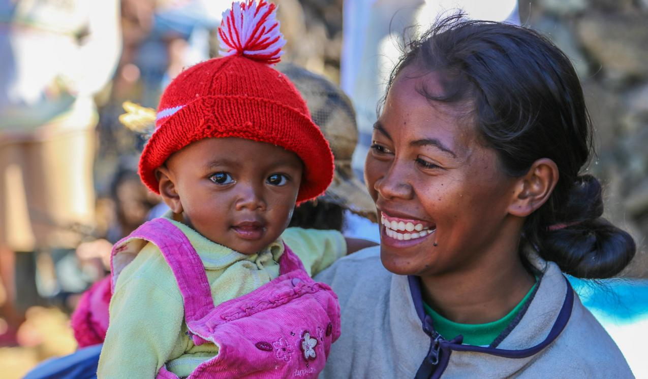 A young mother and her baby visit the local nutrition centre in rural Madagascar.  © Mohamad Al-Arief/The World Bank.