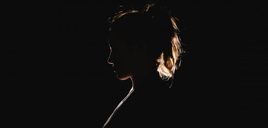 Silhouette of a woman. Photo by Molly Belle on Unsplash
