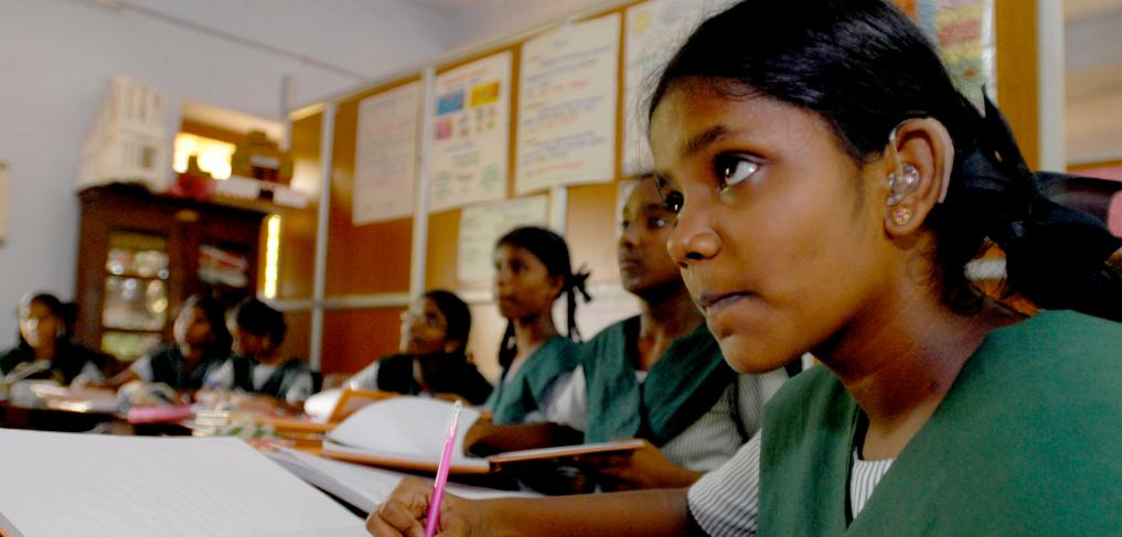 A girl with a hearing aid amongst peers at a school in Chennai, India. © Pippa Ranger/Department for International Development