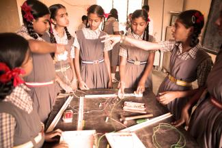 Girls working together on an activity at a school in India. Credit: Charlotte Anderson