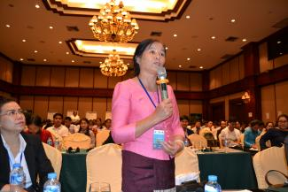 A participant asking a question at the Laos convening