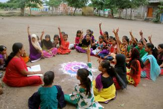 Children take part in an activity about reproductive health