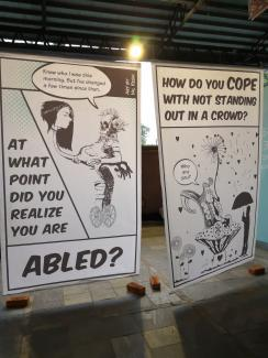 "A sign at the conference with a picture of someone in a wheelchair reads ""At what point did you realise you were abled?"""