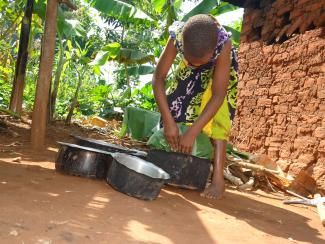 A girl preparing food in Uganda. Credit: Plan International Uganda