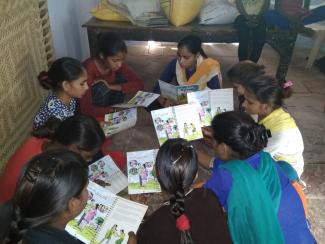 Participants of PAnKH Program, during a session using the PAnKH Diary, in Gujjra Khurd village of Dholpur district in Rajasthan, India. © ICRW