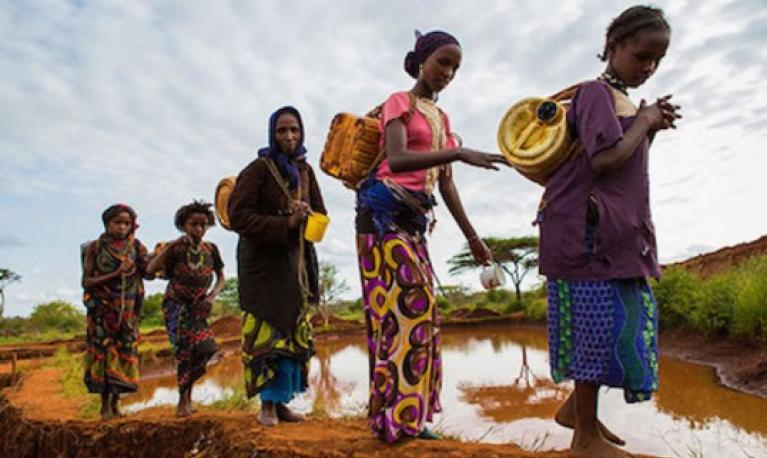 Women going to collect water