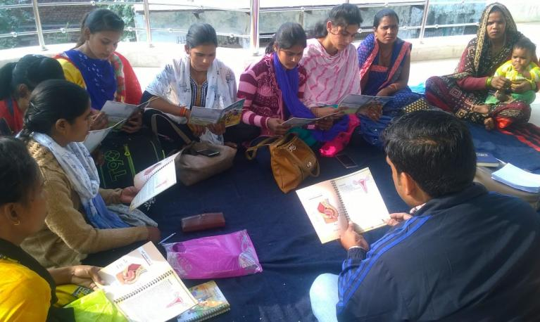 Village mentors preparing for group education session with adolescent girls, using the based on PAnKH Diary, in Dholpur, Rajasthan, India. © ICRW