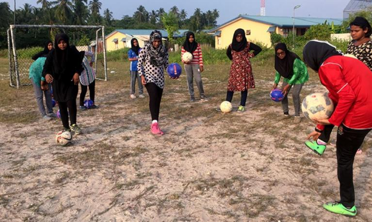 Young women practice their skills on the soccer field. Photo © World Bank