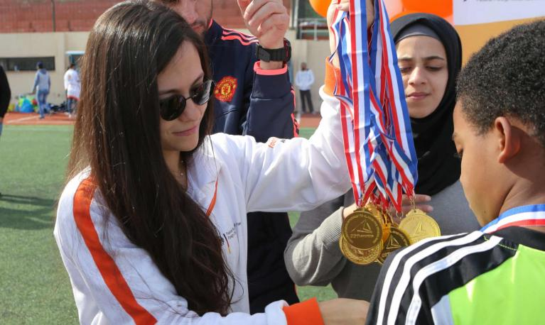 Sarah El Jizi, head coach in the Beirut area for Right To Play, hands out football medals at Nahr el-Bared refugee camp in northern Lebanon. Photograph: Maher Hasbany/Courtesy of Right To Play