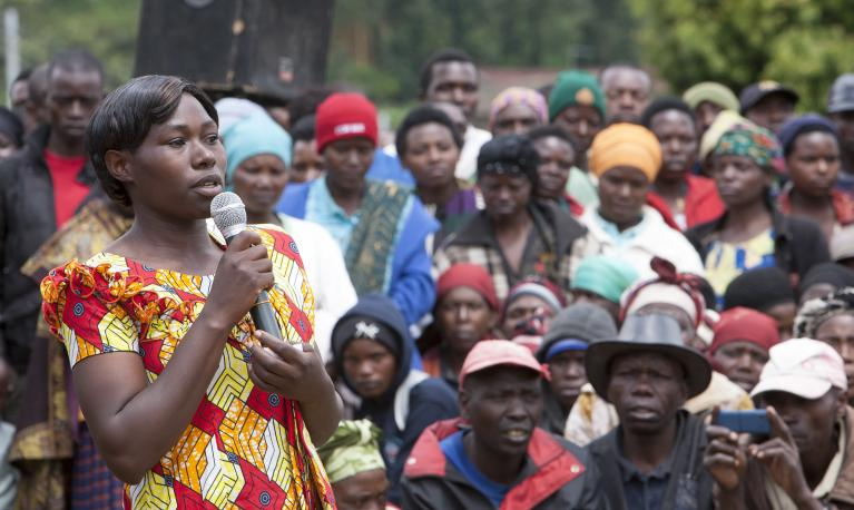 Photo credit: A female employee at a land husbandry site in Nyabihu District, Rwanda, addresses her fellow workers. The site employs about 150 labourers of which 60% are women. Photo: Simone D. McCourtie / World Bank.