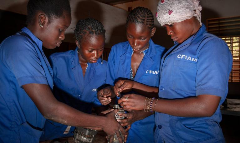 A class for auto mechanic at the CFIAM all-female school in Ouagadougou. ©Jean-Marc Caimi & Valentina Piccinni/The Guardian
