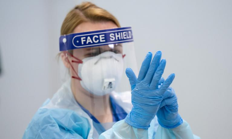 Some female staff are reported to have developed ulcers on their faces from ill-fitting PPE. Photograph: Jon Super/AP
