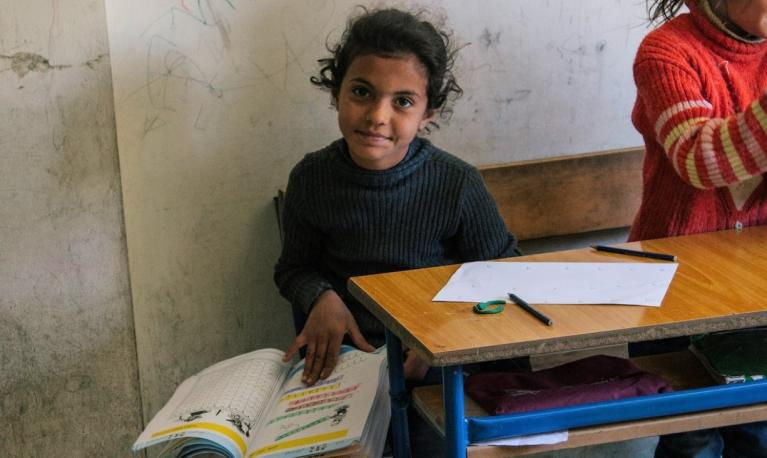 Before the pandemic, a refugee girl studies at a school in Lebanon supported by the Luminos Fund. © Luminos Fund