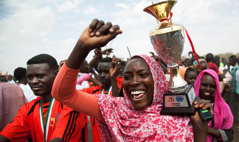 A woman celebrates the closing ceremony of a football competition in Zam Zam camp for internally displaced persons (IDPs) in El Fasher, North Darfur. ©UN Photo/Albert González Farran
