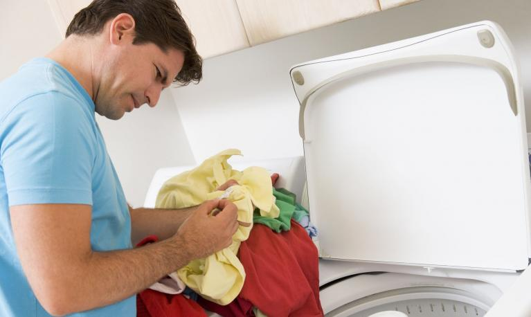 A man doing the laundry. Photograph: Business Images/Rex/Shutterstock