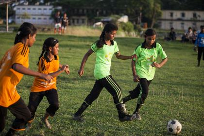 Girls playing football in Nepal