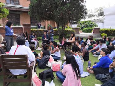 Participants sit outside at the conference