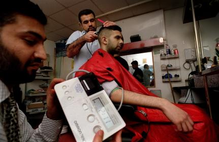 Health checks for men at a barbers' shop in Bradford UK. © Bradford Health of Men project