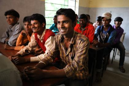 Men smiling in Raniganj, Bihar, India. © Paula Bronstein/Getty Images/Images of Empowerment