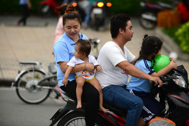 A Vietnamese family of four on a motorbike. © Thanh Tung/Institute for Studies of Society, Economy and Environment