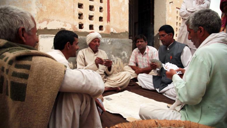 Men playing cards in their community. A scene from the documentary film, A Fine Balance (2015), produced by ICRW and directed by Sanjay Barnela. ©ICRW